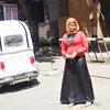 Жена в червено, Едфу, Египет
